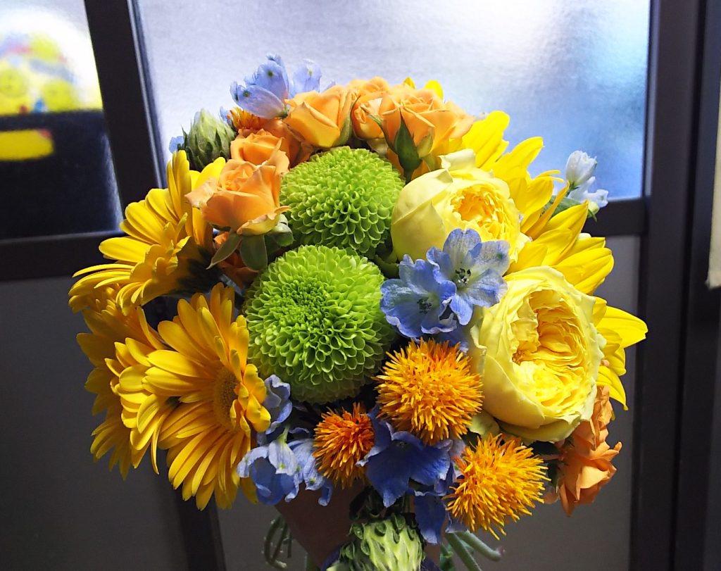 オレンジ・イエロー系の花束